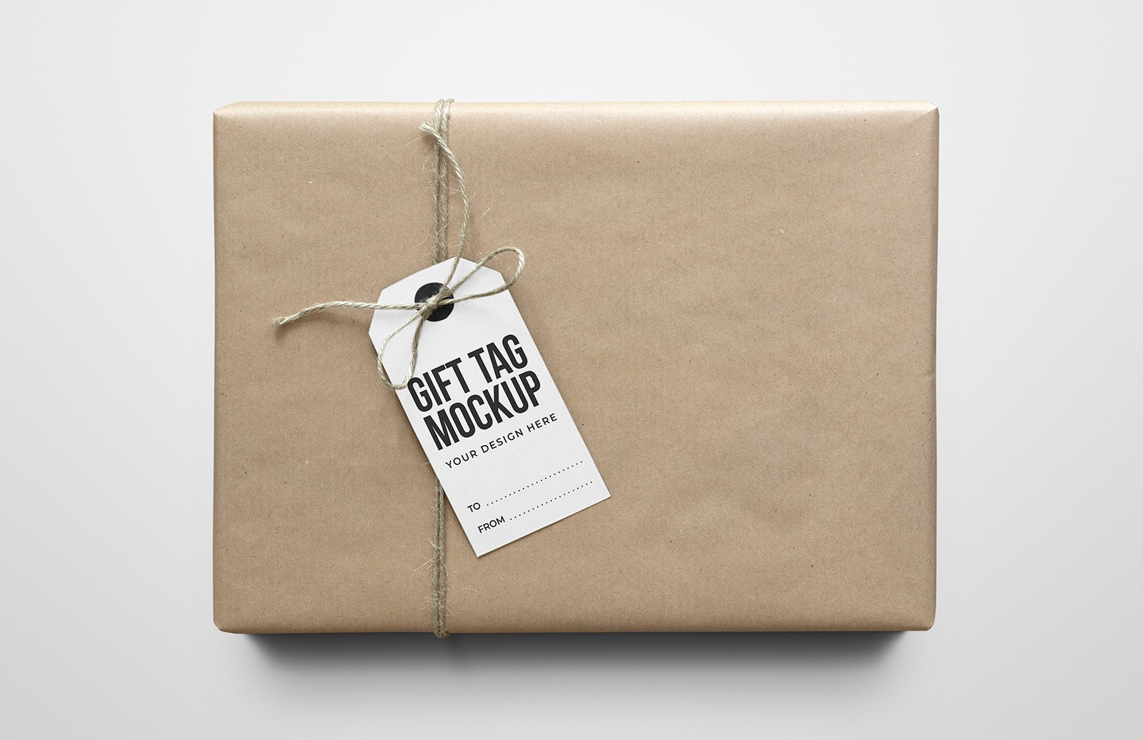 Gift Tag On Craft Paper Package Mockup Preview 1